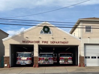 Row of Fire Trucks in Station